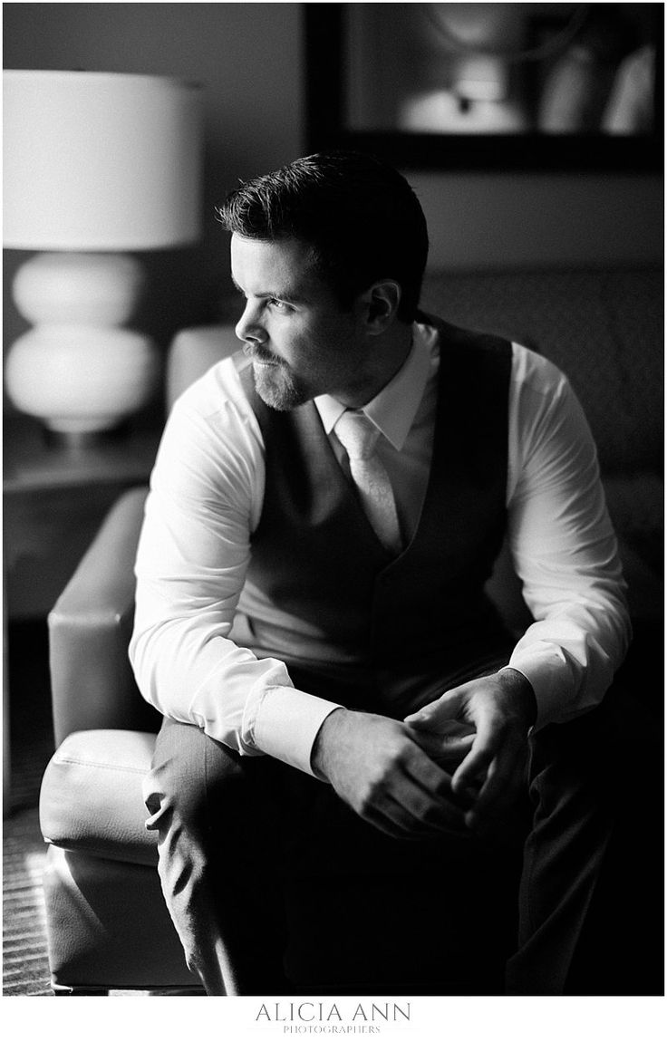 Black and white groom portraits with natural lighting