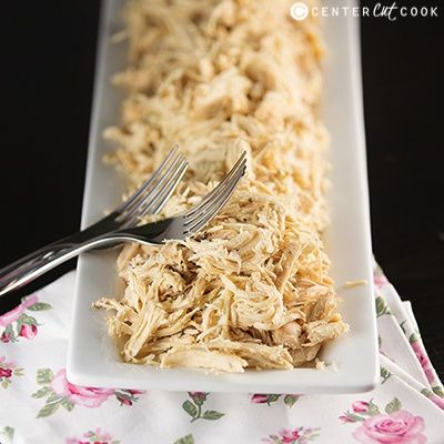 According to this, the easiest way to shred chicken is to put it in your stand mixer?!?!?  MIND BLOWN!  Easy Slow Cooker Shredded Chicken