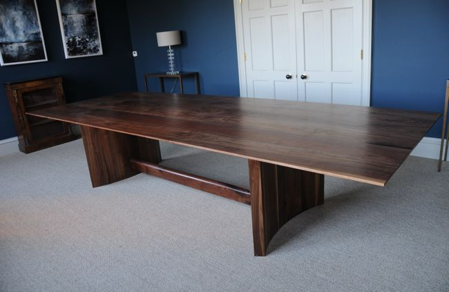 Refrectory style dining table made from solid American walnut with a central bar and curved solid legs. #woodenfurniture #diningtable #interiordesign