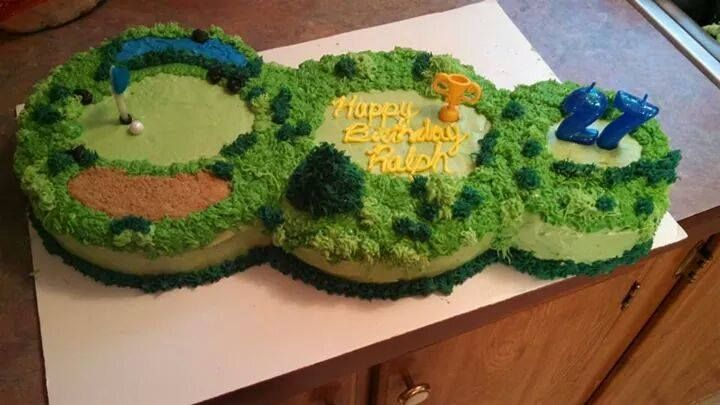 Par 3 Golf Cake. Ralph's 27th Birthday Cake, Red Velvet Cake with Cream cheese icing. Buttercream icing for decorations, Airheads candy for flag, brown sugar for sandpit, Sixlets candy for golfball.