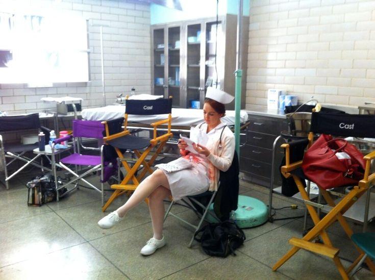 """""""On the set of """"Parkland"""" Nurse studying her lines for ER scene as JFK arrives to Parkland hospital. #jfkassasination"""": Emergency Room, Photo"""