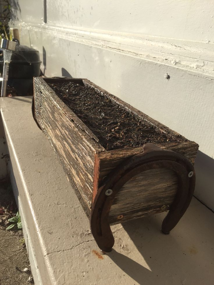 Planter box with horse shoes