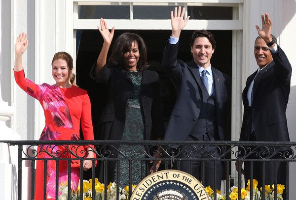 Canadian Prime Minister Justin Trudeau  and Sophie Grégoire-Trudeau wave to invited guests from the Truman Balcony of the White House after an arrival ceremony at the White House, March 10, 2016 in Washington, DC. This is Trudeau's first trip to Washington since becoming Prime Minister.