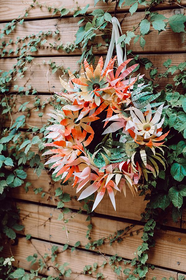 Weekends call for DIYs! Learn how to make this plastic flower wreath tutorial from Ruffled. The perfect centerpiece or design for your next party.  #wreath #flowerwreath #diy