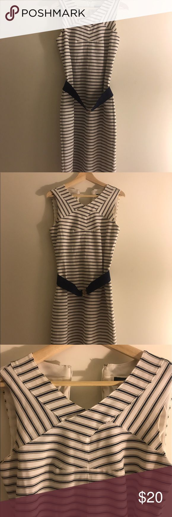 Ann Taylor Striped Bandage Dress with Belt Flaunt your figure in this pre-loved Ann Taylor fitted dress complete with navy blue belt.  This nautical theme dress has a bandage top and is a size 6 and had navy, white and tan stripes.  It pairs well with a jean jacket and espadrilles or on its own for an evening out.  Worn one time. The hem lands just south of the knees. Ann Taylor Dresses Midi