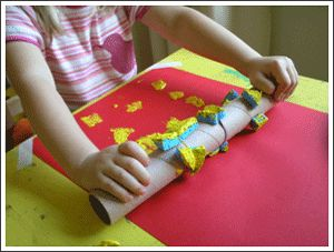 Paint with sponge rubber banded to paper towel roll
