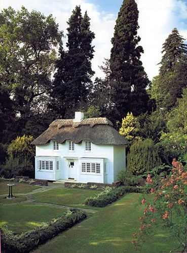 Queen Elizabeth's playhouse, presented to her on her 6th birthday in 1932!  The two-thirds sized, fully furnished Welsh cottage boasts finishing interior touches including a miniature blue and gold china set, a working gas cooker and fridge, Beatrix Potter books and a telephone, all made to scale. The inviting exterior has a front garden with mini hedges and flower borders. Princess Beatrice recently renovated The Little House in honor of the Queen's Diamond Jubilee.