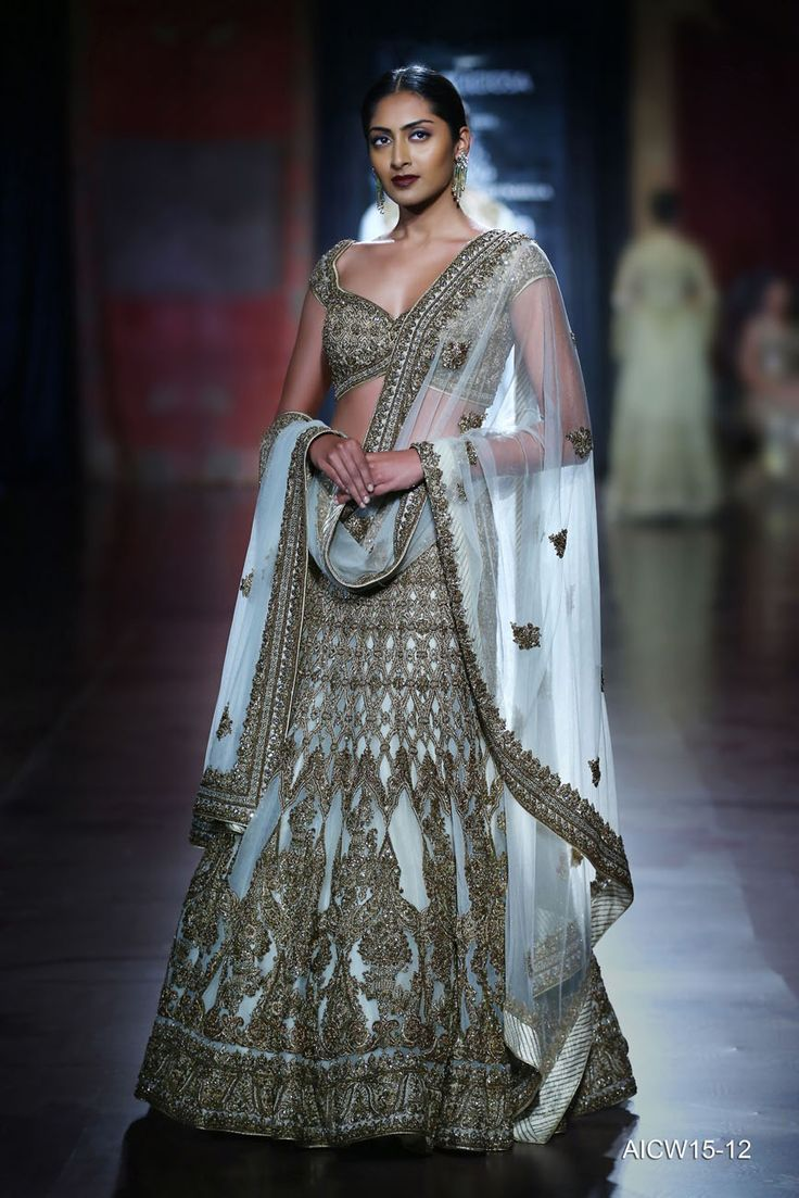 Ivory-gold tulle lehenga-choli featuring very fine hand zardozi paired with a delicate tulle dupatta