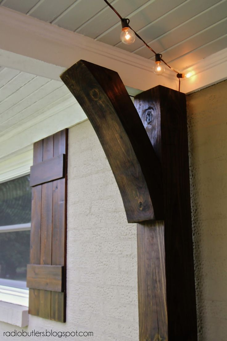 Haint blue bead board ceiling, patio lights, cedar shutters, and stained porch brackets and posts