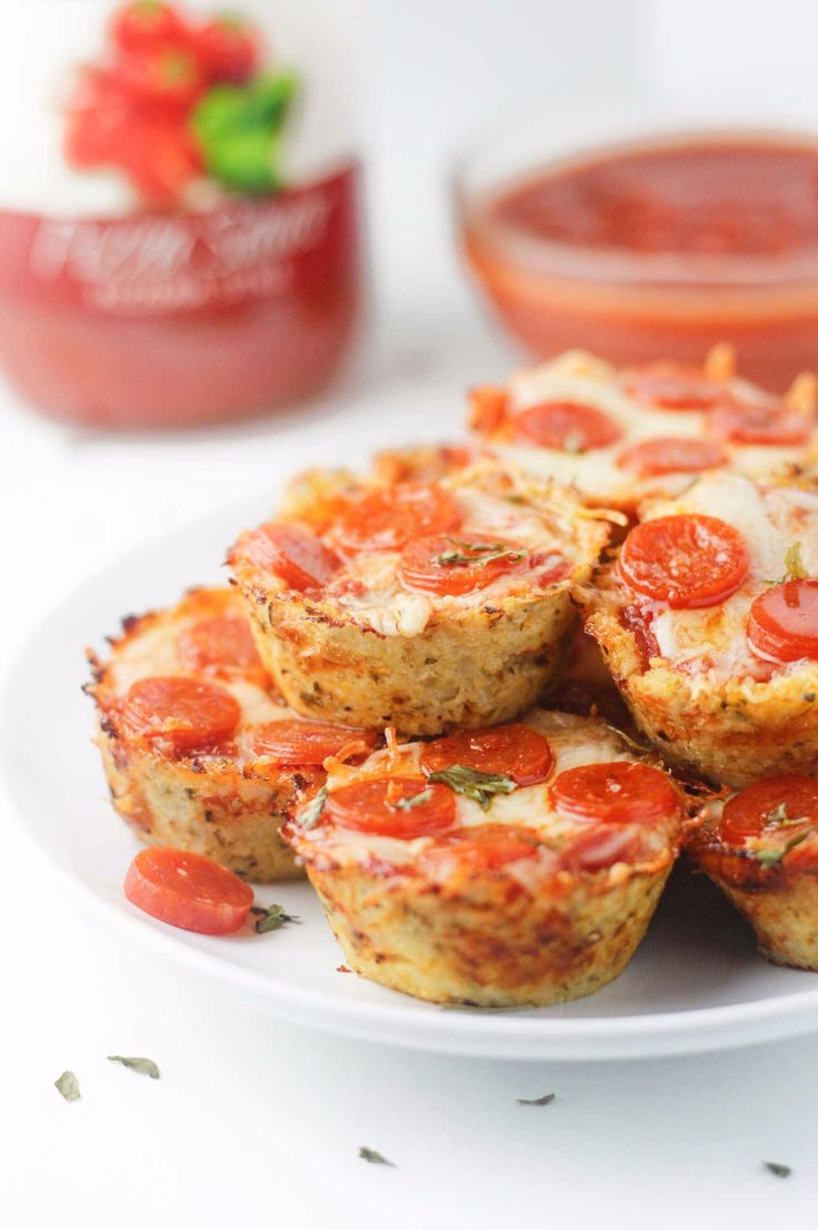 Mini, low carb pepperoni pizzas made with a 3 ingredient cauliflower crust. A deliciously healthy alternative to pizza rolls!