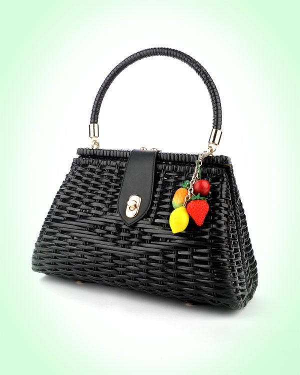 Vintage Inspired Wicker Purse by Pinup Couture Handbags with cute detachable 3D Vintage Fruit Charms. Handwoven from durable vinyl-coated rattan, our sturdy bags feature a beautiful faille fabric lining with open pocket, matching faux-leather closure tab and rose-gold metal details.  $80.00