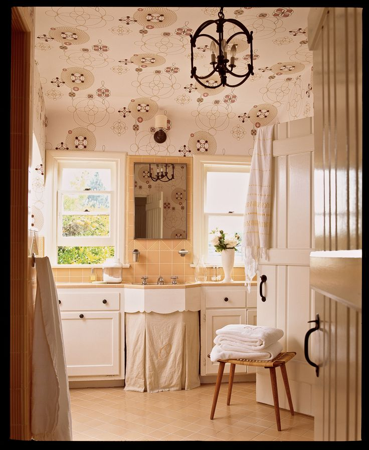 neutral bath with his and hers sinks and curtain drape under sink area iron chandelier