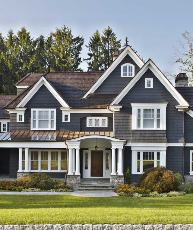 The fantasy of a home with emaculate interiors and a white picket fence is alive and well — on Pinterest at least. This stately slate-colored home in the suburbs of Upstate New York, by DeGraw & DeHaan Architects, takes the cake when it comes to house exteriors.
