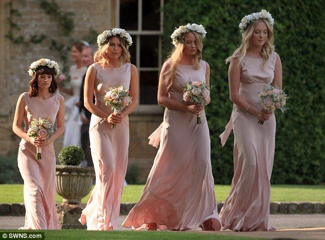 Millie's four bridemads looked stunning in their pink floor length gowns and statement flower garlands