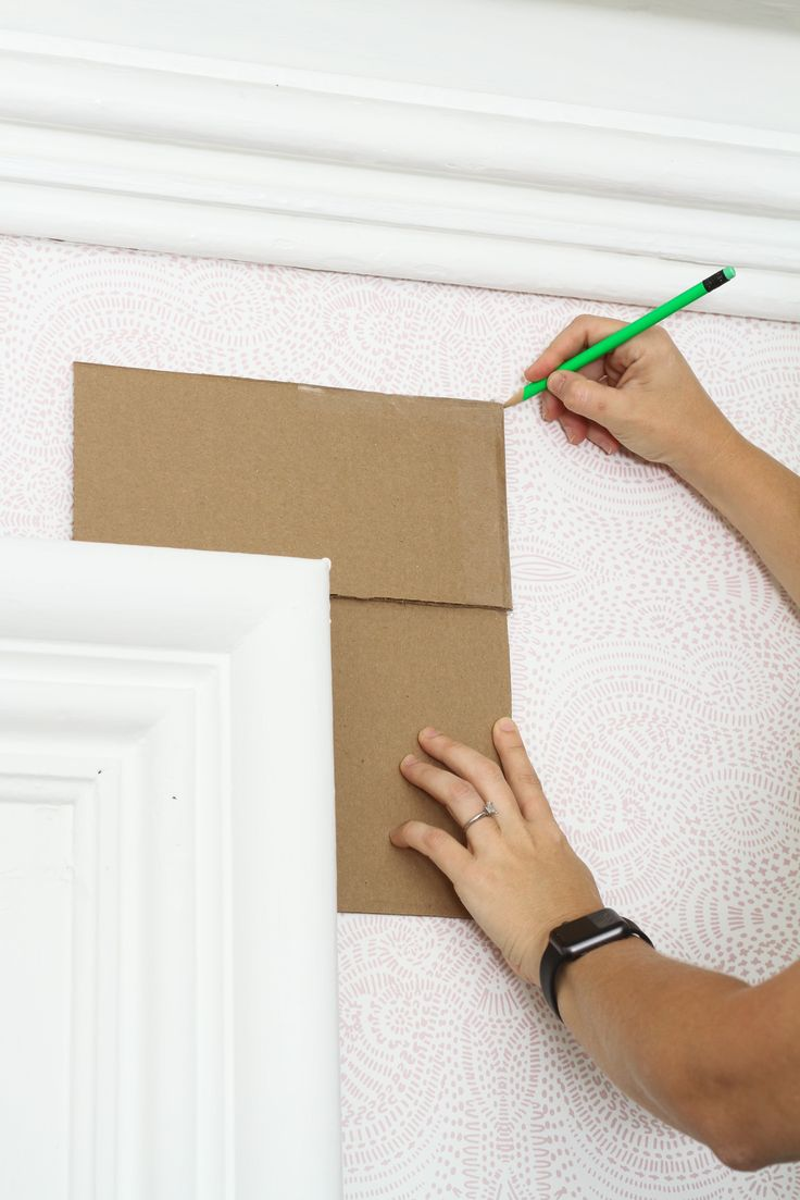A simple template ensures you hang the curtain rod at the same height for every window, and that your rods won't be crooked. The one above was made using a couple pieces of cardboard and saved time otherwise spent measuring from the corner of the windows.