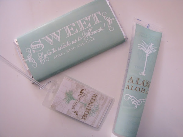 "A close-up of some of the swag in the Hawaii engagement basket - ""Aloe Aloha"", a ""honeymoon bound"" luggage tag, and a sweet treat!"