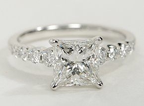 Select your diamond of choice for this diamond engagement ring setting crafted in 14k white gold.