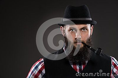Muscular Tattooed Man Holding A Pipe In His Mouth - Download From Over 50 Million High Quality Stock Photos, Images, Vectors. Sign up for FREE today. Image: 51823768