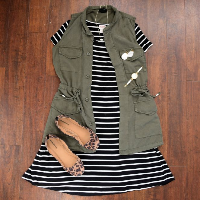 green utility/cargo vest, striped dress, and leopard flats