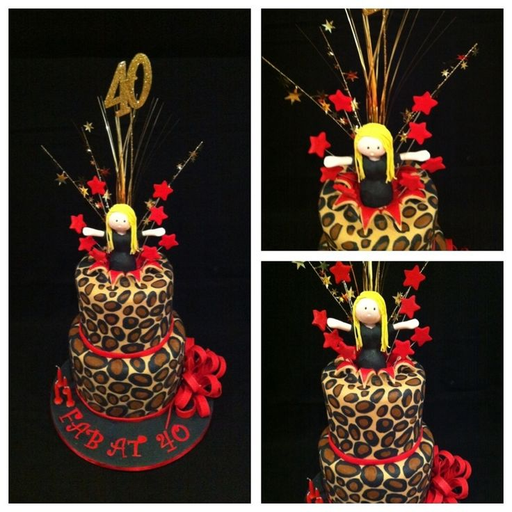 Cheetah print cake with a girl jumping out if it - Double tier with cheetah print & red with a girl popping out with an explosion.