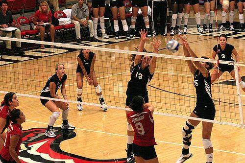 Mountain West Conference Volleyball: A Double Block against a UNLV Hitter   Photo by Chris Daines