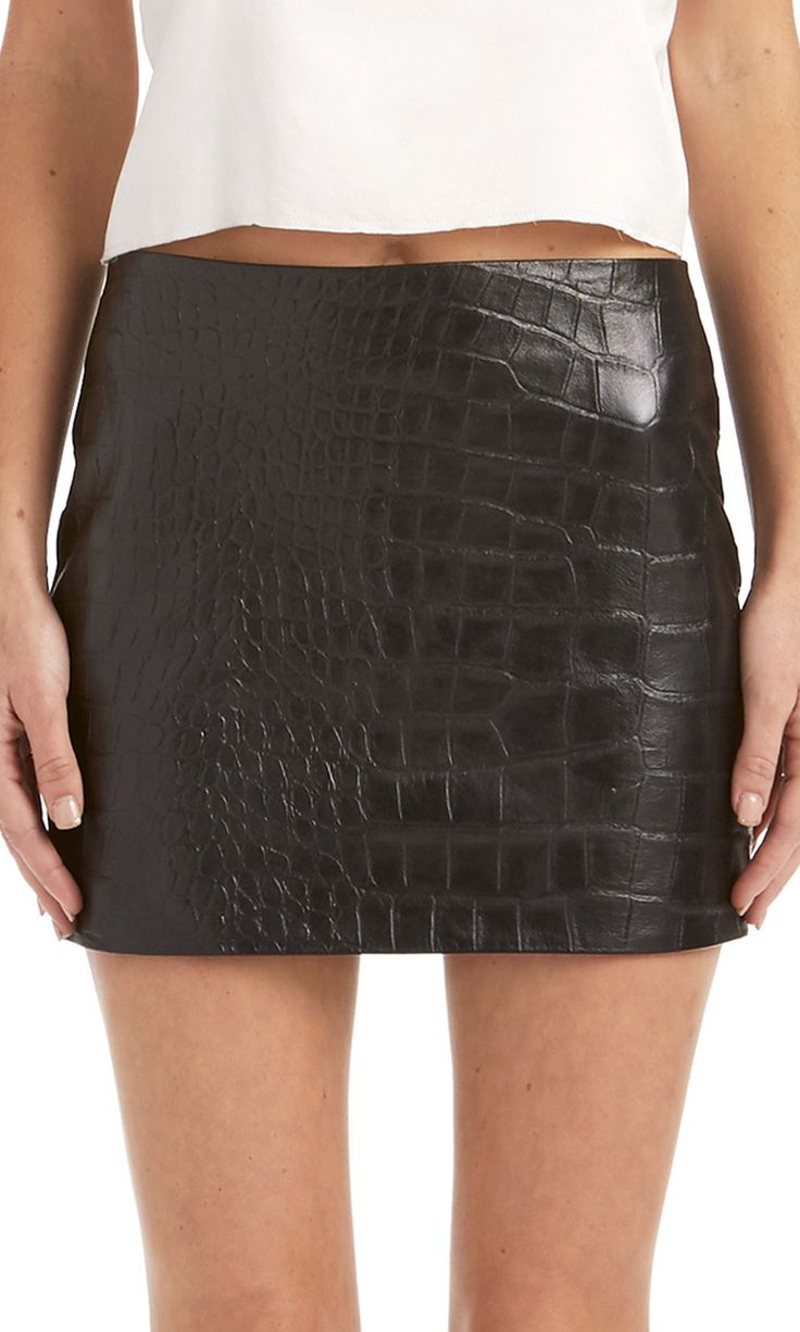Our Kiviskirt is the same body conscious cut as our Kell but this time in a badass crocodile embossed leather.Lined in soft100% silk charmeuse and closes wit