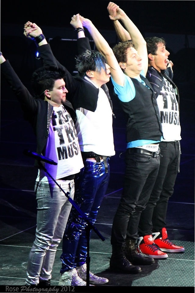 These guys really saved my life. Their songs brought me out of depression and saved me from cutting. I came without scars because of these four guys right there.