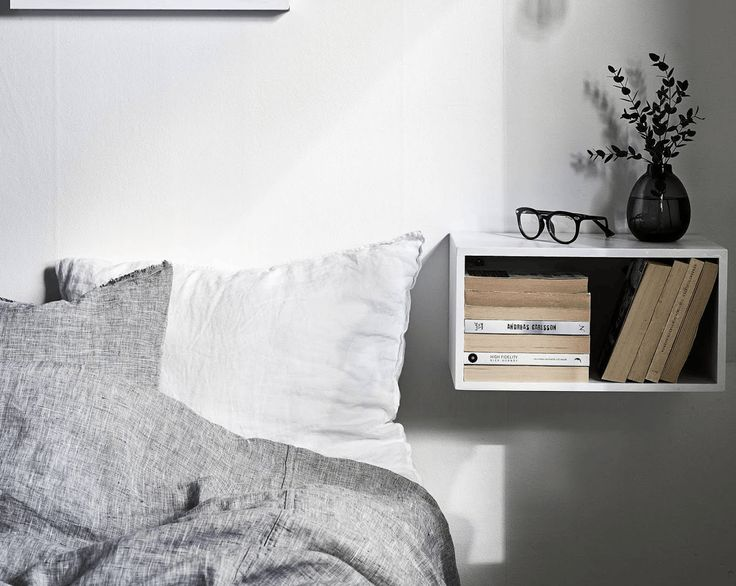 bed with floating nightstand shelf