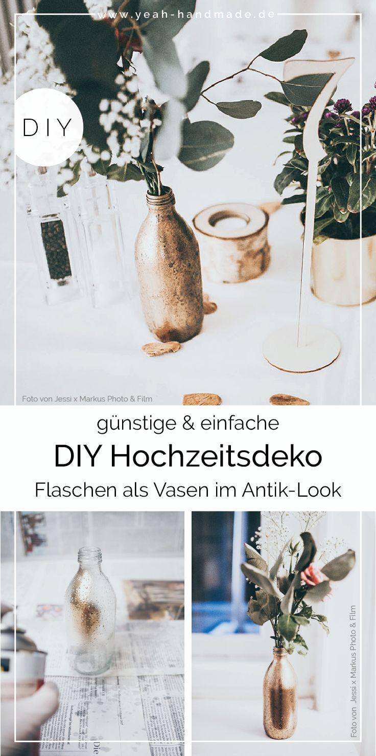 DIY Hochzeitsdeko: Goldene Flaschen als Vasen selber machen