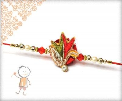 Fancy #Rakhi  Collection 2015 – Send #Rakhi to #India, #USA, #UK, #Canada, #Australia, #Dubai  #NZ #Singapore.  Traditional Red Resham Zardosi Rakhi, surprise your loved ones with roli chawal, chocolates and a greeting card as it is also a part of our package and that too without any extra charges.  http://www.bablarakhi.com/send-fancy-rakhi-online/730-send-traditional-red-resham-zardosi-rakhi-online.html