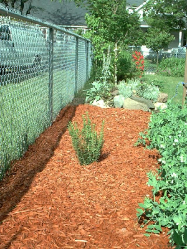 What Are Landscape Fabrics and How Can I Use Them?: After Laying Landscape Fabrics: Mulching, Planting