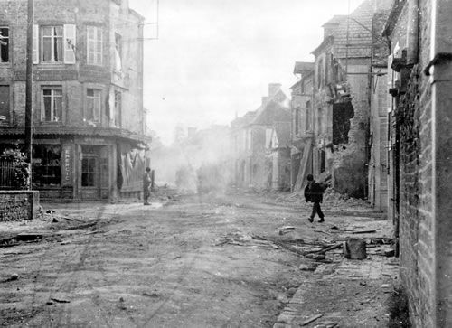 SAINTE MERE EGLISE Street scene in the village after its liberation by U.S. Troops. Looking East – June 1944.