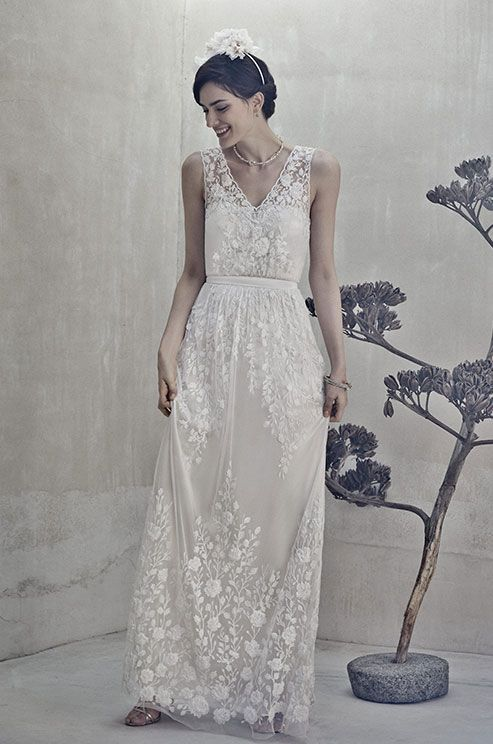 Exquisitely embroidered and showered in delicate three-dimensional flowers, this silk gown is reminiscent of a summer garden in full bloom. BHLDN, Spring 2014