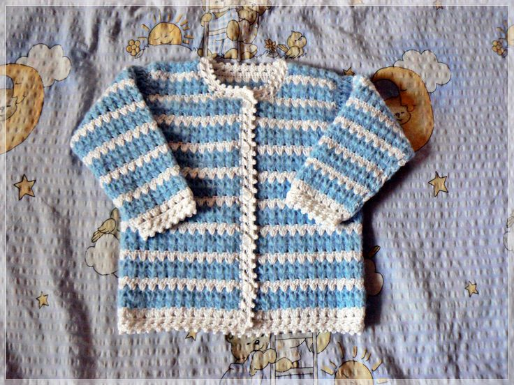 Crochet cardigan in blue and white stripes.