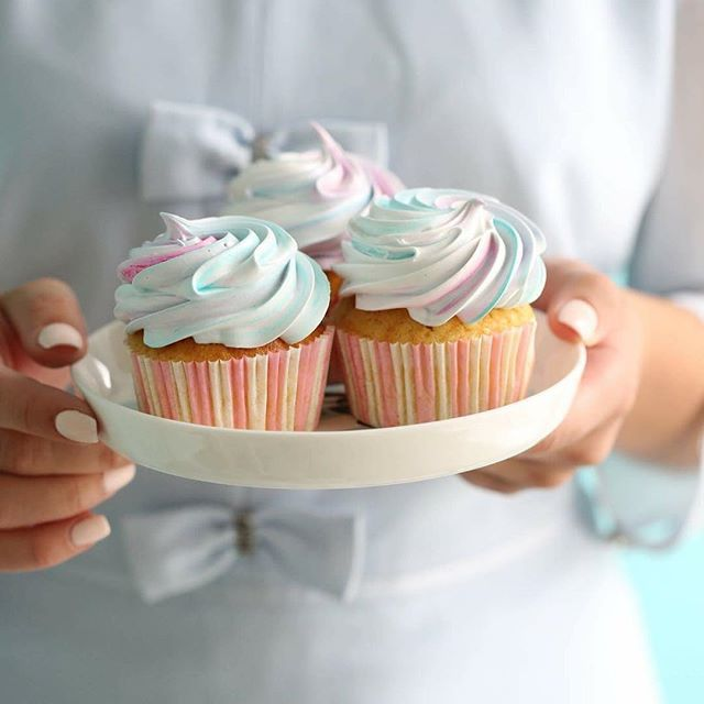 Cotton Candy vanilla cupcake topped with a colorful pastel swirl of cotton candy fluff. #newbook #cupcake #cottoncandy