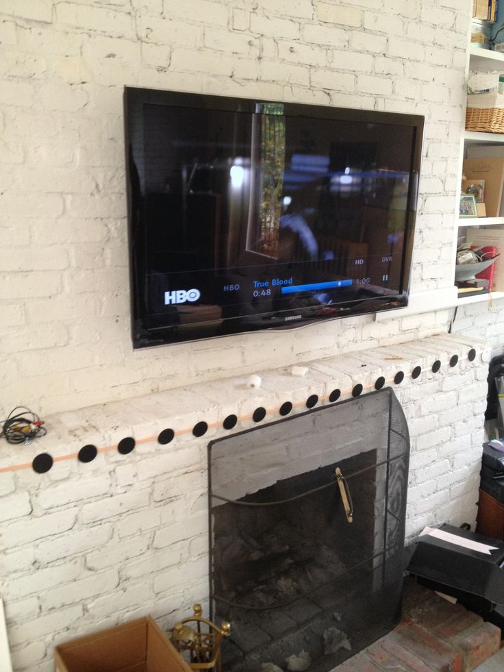 Tv Mounting Over A Brick Fireplace With Wires Concealed In