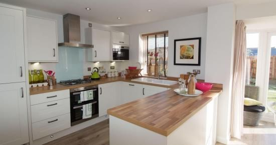 Large open-plan kitchen and dining area with French doors leading onto the garden. This type of layout is ideal for entertaining friends and family.  #newhomes #property