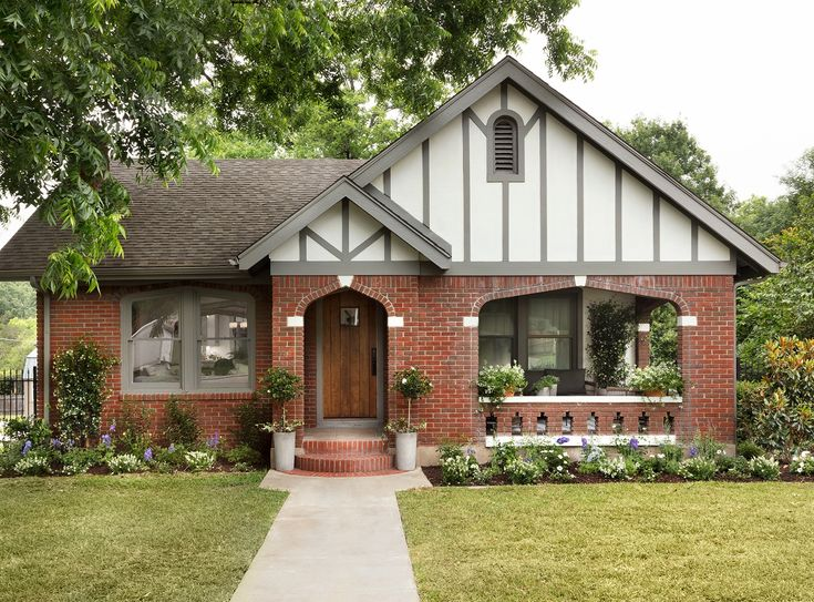 I loved the red brick on the exterior of the home, so we simply power washed it so that it looked fresh and clean. We also enhanced the tudor style by adding in stucco and detailed trim work to the front and side of the exterior.
