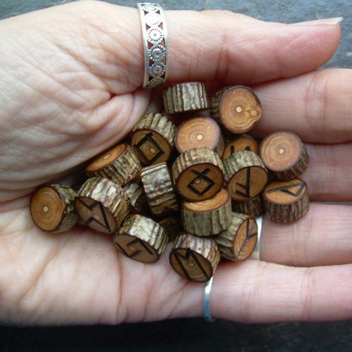 wooden runes. use them for alphabet activities, counting activities, block-building, what other games could I think of???use like dice?heads or tails?