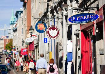 Quebec City - Best Cheap Cities to Visit from Food & Wine: Canada Travel, Quebec Cities, Clothing Shops, Cheap Travel, Cheap Cities, Street Signs, Cheap Places, Montreal Quebec, Vintage Clothing