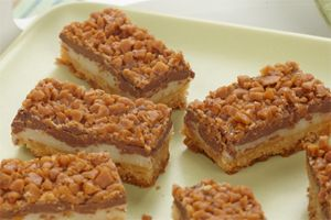 Toffee Chocolate Bars- Got a craving for chocolate, chocolate and more chocolate? With crunchy toffee, creamy chocolate and a crisp cookie base, these treats are sure to satisfy your sweet tooth.