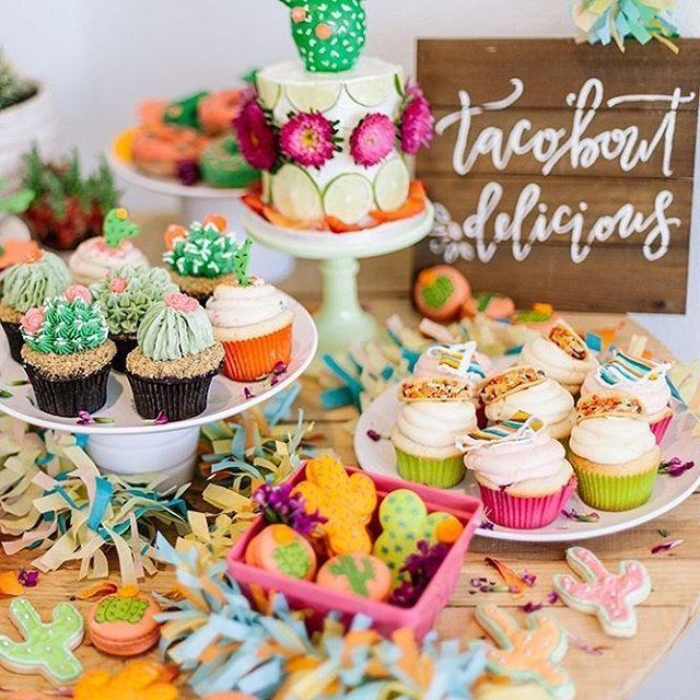 We're drooling over this desert-themed dessert table, which features super cute mini taco cupcakes (yep, you read right!), a cactus cake, cactus macarons and cactus doughnuts—taco 'bout delicious! See all the pictures of this super cute 2nd birthday on the #hooraymag #blog. Photography by @dulcetcreative + styling by @theshiftcreative + desserts by @sweetnsaucyshop x