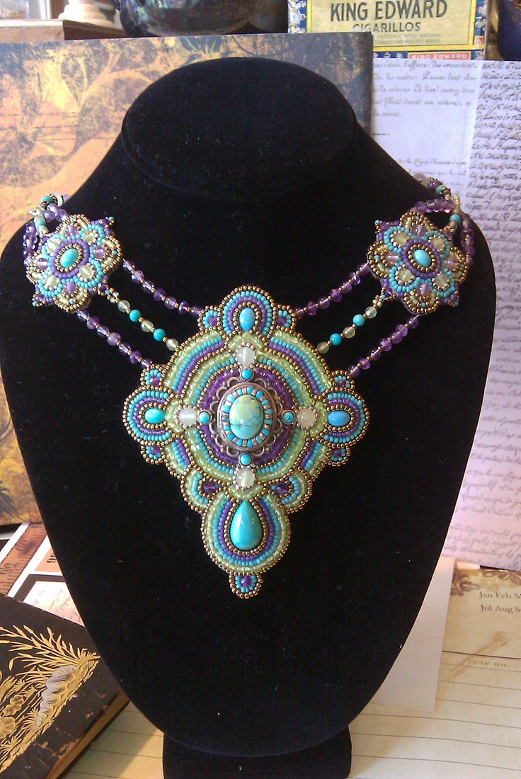 Bead embroidery sterling silver, turquoise, Amethyst, Peridot, Art Deco with an Aztec feel. $ 245.00, via Etsy.
