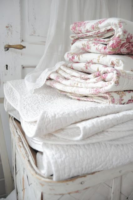 Lovely way to leave extra blankets for a spare bedroom.  Piled up high in a basket.