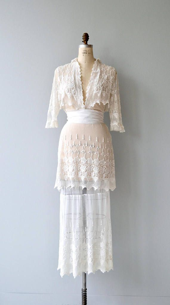 Antique 1910s white silk net lace dress with 3/4 sleeves, overjacket effect (all is attached), fitted waist, tiered skirt, wrapped sash waist and metal clasps along the bodice and waist.  --- M E A S U R E M E N T S ---  fits like: small bust: 36 waist: 26 hip: 37.5 length: 60 brand/maker: