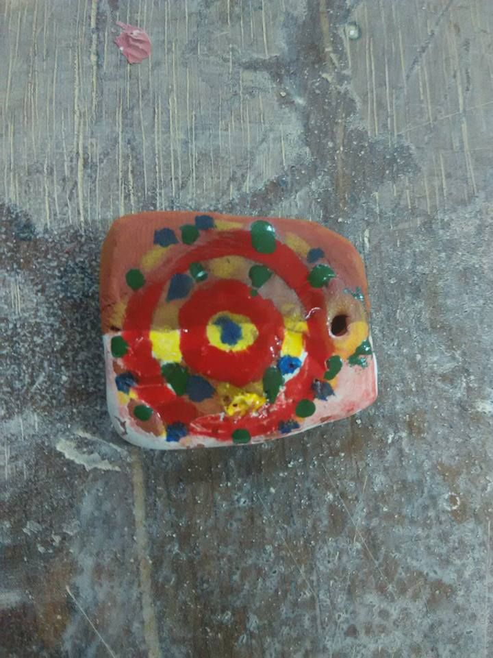 unglazed small tile painted with idilyc.