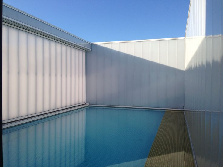 Swimming pool vertical glazing made in Polycarbonate panels by Rodeca GmbH