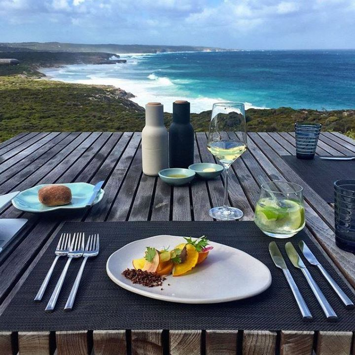 Lunch at Southern Ocean Lodge, Kangaroo Island, Australia - paired with incredible views of the ruggedly beautiful Kangaroo Island in South Australia. Yes please! - Photo by @pk_alexander