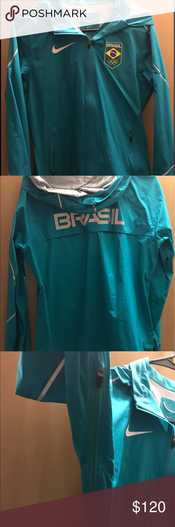 "Nike shield Olympic team Brazil running jacket NWOT.  Retails super expensive at the time and I don't think they sell/make this jacket anymore. Women's size medium. ""Swishy"" material, very light weight. Hood and zippers under arm pits.  Has drawstring on bottom to tighten for size. Nike Jackets & Coats Utility Jackets"