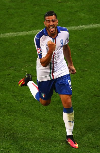 Graziano Pelle of Italy celebrates scoring his team's second goal during the UEFA EURO 2016 Group E match between Belgium and Italy at Stade des Lumieres on June 13, 2016 in Lyon, France.